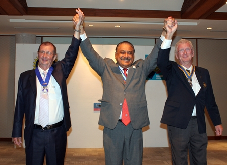 PDG Peter Malhotra proclaims Gerard Porcon (right) as the new president of the Rotary Club Pattaya Marina as Joseph Roy (left) successfully completes his term of office.