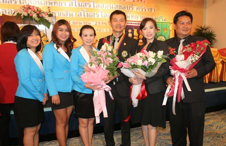 Praichit Jetpai, president of YWCA Bangkok-Pattaya Center, with members congratulate the newly appointed Lions Club committee members.