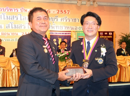 Visit Ekakh (left), member of the Lions Club of Pattaya, is presented a special  plaque of honor for being the outstanding Lions club member this year.  He is receiving the award from Burin Chantharakkarnkha, former president of the Lions Club of Pattaya.