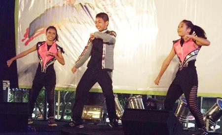 Children dancing to music.