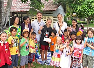 Poppy (centre) with her family and Yok.