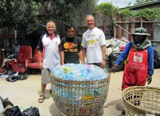 Bill, Mr. Rung and Woody at the recyclable center with a basket of plastic bottles the students gathered over the last term.