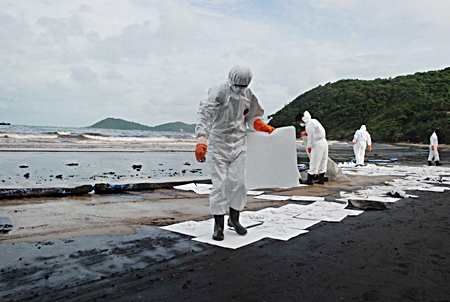 Clean up crews work to clean up the mess July 29 on Ao Prao Beach.