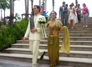 The wedding entourage makes its way from Beach Road into Central Festival Pattaya Beach.