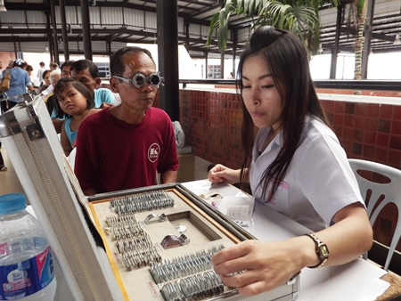 Pattaya citizens trying on glasses to find the one that suits their personality best.