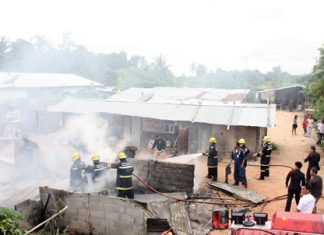 It took firefighters about 30 minutes to extinguish the fire that swept through two houses at a Sattahip construction camp.
