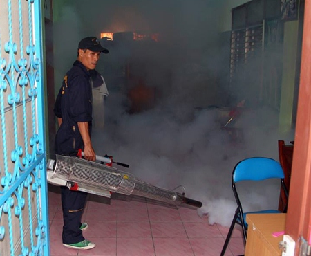 City workers go house to house in North Pattaya, spraying insecticides to kill mosquitoes.