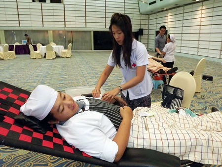 A nurse extracts blood from one of many Asia Hotel employees who took the time to donate earlier this month.