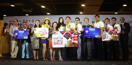 Pattaya Grand Sale 2013 sponsors take a group picture at the press conference launching the event at Central Festival Pattaya Beach.