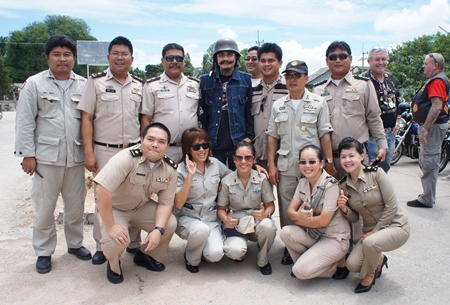 Lek Carabao (standing center) poses with some of the guards for a photo they will never forget.
