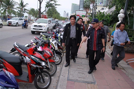 Pattaya Deputy Mayor Ronakit Ekasingh (left) and Banglamung District Chief Sakchai Taengho (center) inspect rentals taking up precious Beach Road and sidewalk real estate.