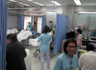 Medical staff at Pattaya Memorial Hospital tend to the ill patients from Chiang Mai.