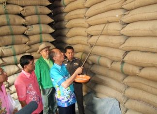 Gov. Khomsan Ekachai led police and government officials in checks of five rice warehouses in Chonburi City and two in Phanat Nikhom.