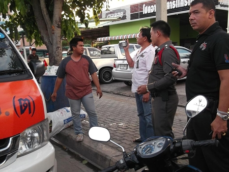 Nattapong Sutthikaew (front left, standing next to his van) has been questioned for allegedly raping a Thai go-go dancer.