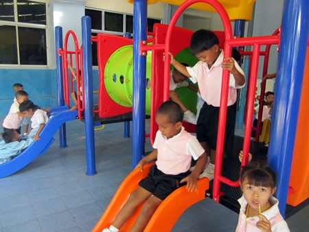 Children at the Triamsuksa Foundation School in Chantaburi enjoy their new playground.