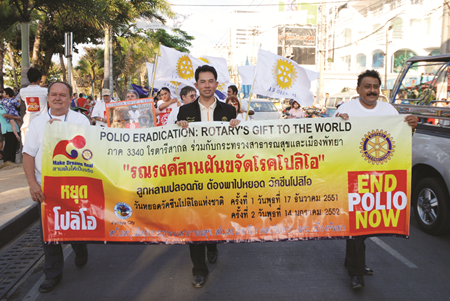 """2009 - (L to R) PDG Prempreecha Dibbayawan, Mayor Itthipol Khunplome, and District Governor of Rotary International District 3340 Pratheep Malhotra lead a procession along Beach Road to spread the """"End Polio Now"""" message."""