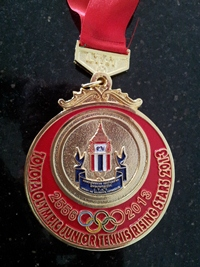 Thitirat's medal from a Toyota Rising Young Stars of Tennis event.