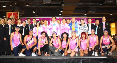 Race organizers, city officials and sponsors pose with runners following the July 12 press conference to announce details of this weekend's King's Cup Pattaya Marathon.