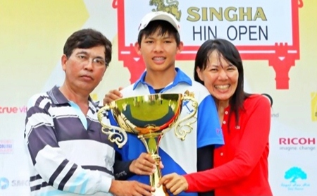Pachara Khongwatmai (center) is flanked by his parents as he poses with the champion's trophy following his victory in the Singha Hua Hin Open at Royal Hua Hin Golf Course, Sunday, July 21.