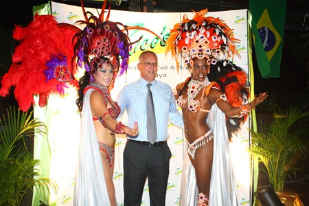 H.E. Paulo Cesar Meira De Vasconcellos, the Brazilian ambassador to Thailand, poses with Zico's dancers during the opening of the Brazilian food festival, Thursday, August 8.