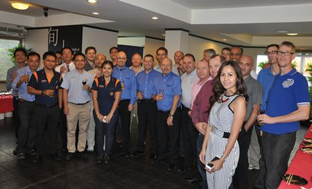 The Automotive Focus Group poses with Triumph Motorcycles' staff after touring the manufacturing facility in Amata Nakorn.
