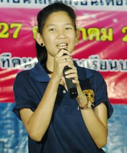 Suchakorn Krajangjit, outgoing president of the Interact Club of Banglamung School launches the ceremony.