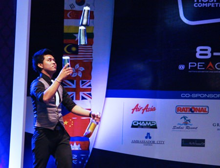 Jarinth Suttiwaja shows off his bartending skills in the Mekong Pattaya Signature Drink Menu Search competition.