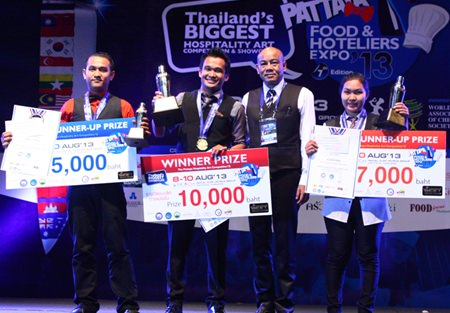 Yuppharat Wongdowngul (2nd right), President, F&B Management Association Eastern Region of Thailand, poses with the top three winners in the Mekong Pattaya Signature Drink Menu Search, including winner Ubon Masuk (2nd left) from Mountain Beach Hotel (middle).