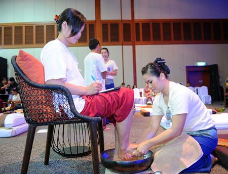 Participants in the Thai Massage Competition massage the judging committee.