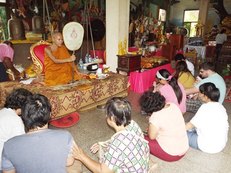 Buddhists listen to sermons and make merit at Wat Suttawas in Nongprue.