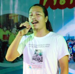"Nopawad Samanrak sings ""Father Ray in our Heart""."