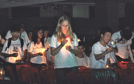 A somber candlelight ceremony caps off the activities in memory of Father Ray.