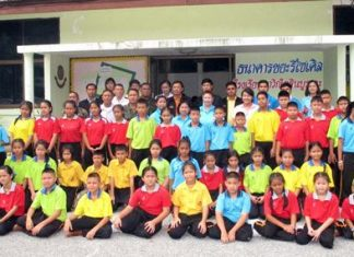 Teachers, local officials and students ready themselves for the new recycling project.