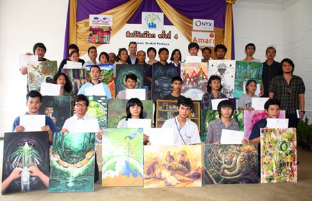 20 students display their prize-winning drawings highlighting environmental conservation, with sponsors and the judging committee at the Amari Orchid Resort & Tower.