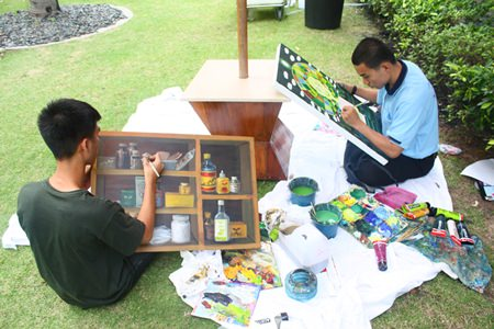 Youths give their masterpieces finishing touches before time ran out to enter them in the 4th Art for the Planet competition.