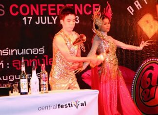 Woodlands Hotel & Resort's bartender shows off his skills, accompanied by the hotel's Miss Bartender, during the press conference announcing this year's Pattaya Bartender Competition Aug. 28.