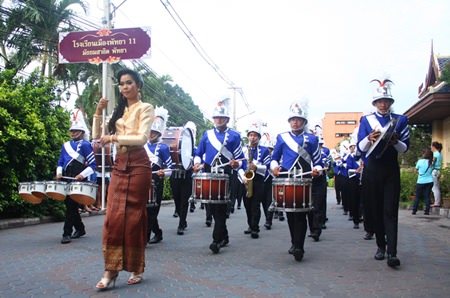 The Pattaya School No. 11 marching band leads the HM the Queen parade in front of Laem Bali Hai.