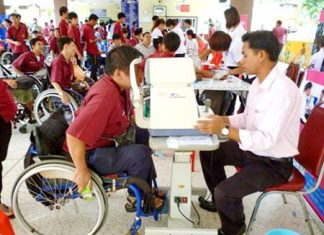 "Disabled area residents are given free health screenings from Pattaya Hospital as part of the city's ""Pattaya Maintains Good Health"" program."