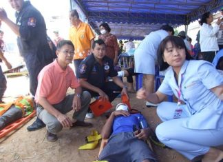 Residents and rescue workers practice emergency drills in Song Pheenong, Rayong.
