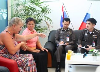 Pol. Col. Suwan Chiewnawinthawat (right) and Pol. Lt. Col. Anek Srathongyuu listen to complaints from Russians at the Russian Convenience Center in Jomtien.