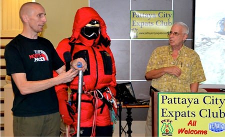 With the aid of a manikin, David demonstrates the clothing and gear necessary to climb Everest, including the ice pick. MC Richard Silverberg looks on.