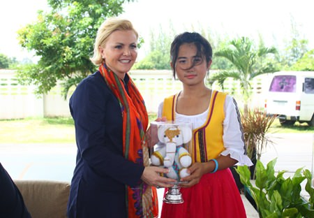 The ambassador's lovely wife Uschi Peterlik exchanges a gift with one of the dancers.