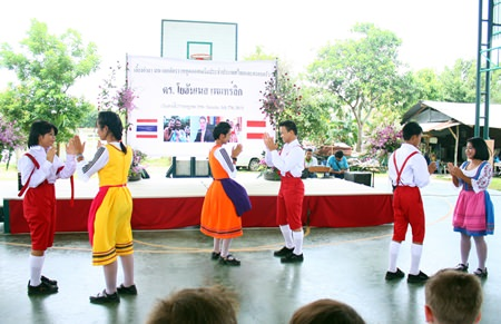 The children thank the ambassador and his family by performing a dance featuring Austrian costumes.