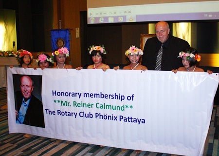 Young dancers from the Pattaya Orphanage congratulate Rotary Phoenix-Pattaya's newest honorary member, Reiner Calmund.
