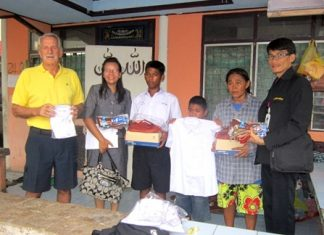 Youngsters receive their school uniforms.