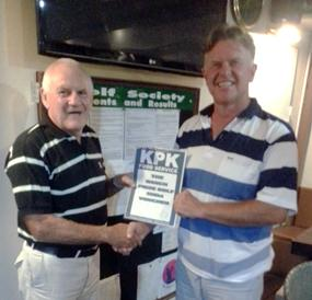 Tony presents the KPK voucher to Colin Greig.