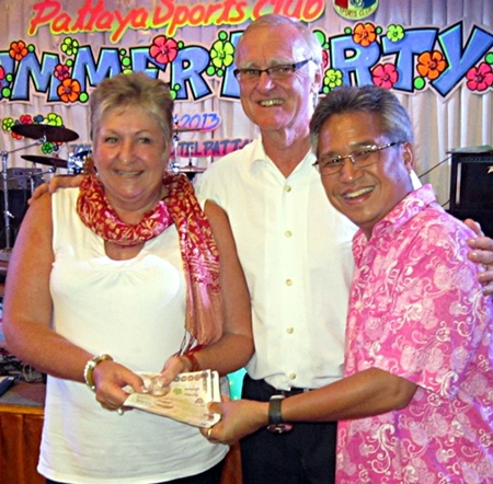 Mike (right) and Tony present a cash prize to a lucky lady.