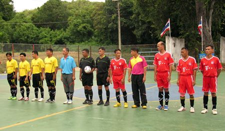 Navy teams line up for a football match as part of the 2-week sports competition at Sattahip Naval Base.