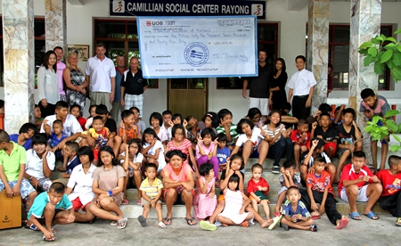 Camel Charity Classic organizers present a cheque for 1,061,735 baht to the administrators and children of the Camillian Social Center in Rayong, Saturday, July 27.