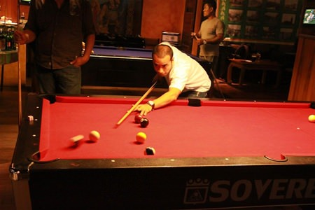 Phadet from the Sheraton Pattaya Resort pots another ball in the final.